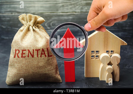 Bag with the money and the word Rental and up arrow with family and home. Raising the rent on housing. Increased demand for rental apartments. Payment - Stock Photo