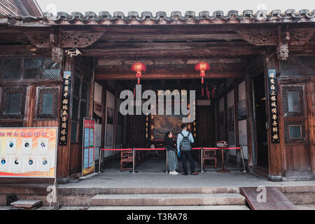 Sanfang Qixiang (Three Lanes and Seven Alleys), Fuzhou, China - 05 April 2019: People visiting the famous travel destination and walking on the Street - Stock Photo