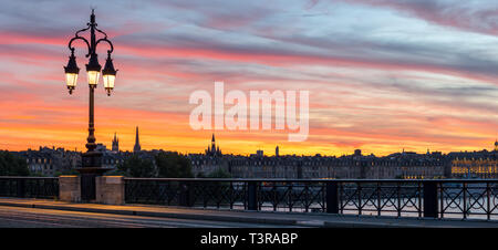 Beautiful panoramic view of Bordeaux city and the Stone Bridge at sunset time, France. - Stock Photo