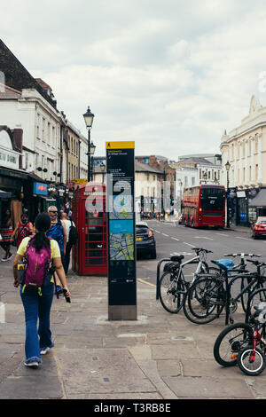 London, UK - July 23, 2018: information board on the Greenwich Church Street towards South bank of the river Thames. Red telephone box and a double de - Stock Photo