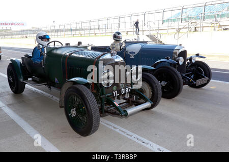 Two Pre-war Bentley Race Cars line up on the International pit lane,  to take part in a parade lap as part of the Centenary Celebrations, at the Silverstone Classic Media Day 2019 - Stock Photo
