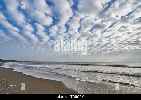 Beautiful scenics of Qiaotou Beach with flowing clouds and waves from the south china sea at Qiaotouhaitan park in Tainan, Taiwan. - Stock Photo