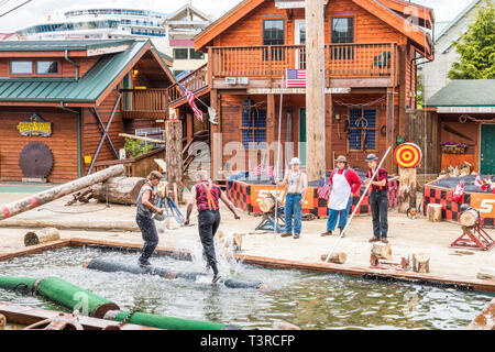 Log rolling demonstration at the Great Alaskan Lumberjack Show in Ketchikan, Alaska USA - Stock Photo