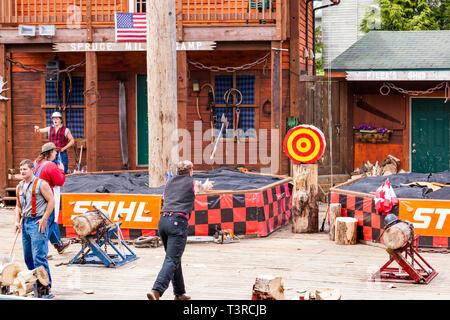Axe throwing demonstration at the Great Alaskan Lumberjack Show in Ketchikan, Alaska USA - Stock Photo