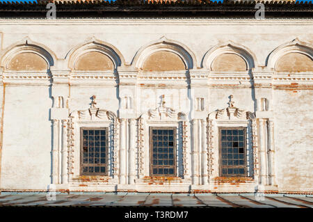 Veliky Novgorod, Russia. Windows decorated with arches and stucco at the facade of Resurrection Cathedral of Derevyanitsky monastery - Stock Photo