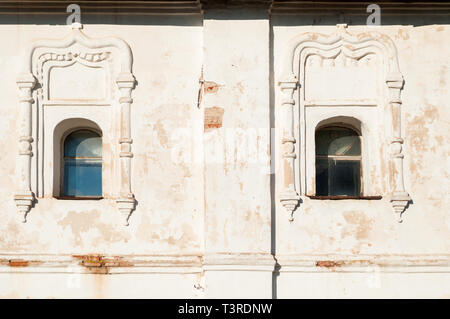 Veliky Novgorod, Russia. Windows with arches and stucco at the facade of Resurrection Cathedral of Derevyanitsky monastery - Stock Photo