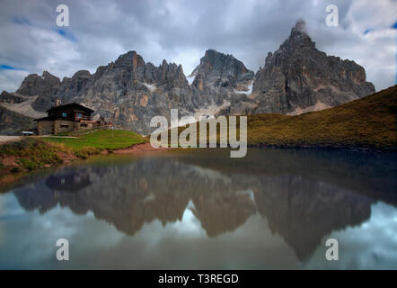 The whole range of the Pale di San Martino, one of the most famous and beautiful groups of the Dolomites, reflected in the waters of a small lake near - Stock Photo