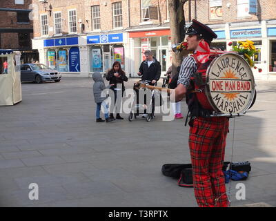 One man band performer Laurence Marshall performing in Kings Square, York, UK - Stock Photo