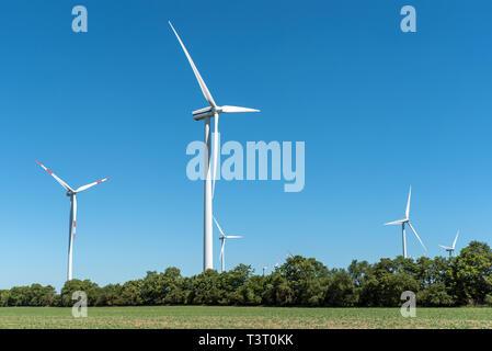 Wind wheels in the fields seen in rural Germany - Stock Photo