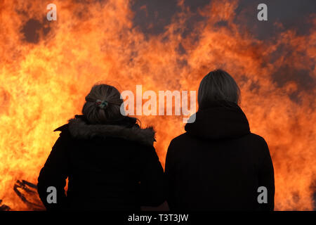 Norway, two young ladies, midsummer night fire - Stock Photo