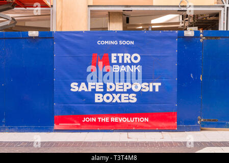 Large sign on hoarding outside new branch of Metro Bank which will open shortly in Birmingham, UK - Stock Photo