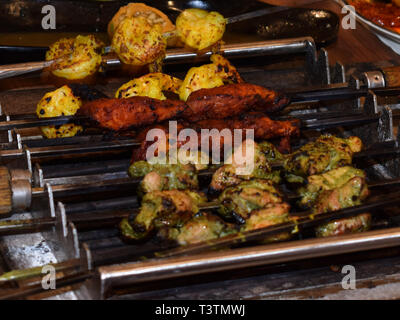 Delicious and spicy Indian Kebabs ( food grilled over burning charcoal fire) - Stock Photo