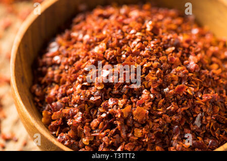Spicy Organic Red Aleppo Pepper in a Bowl - Stock Photo