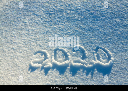 abstract  winter New Year's and Christmas background from snow.text on snow 2020 - Stock Photo