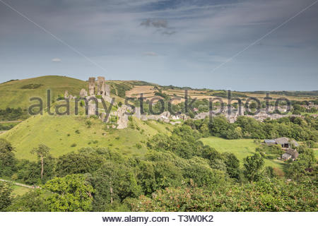 A summer view over Corfe Castle, a village and civil parish in the English county of Dorset - Stock Photo
