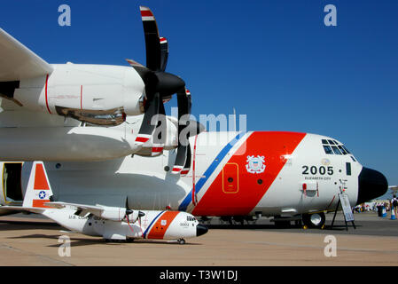 United States Coast Guard Lockheed HC-130J Hercules transport plane with similar model plane on display at RAF Fairford airshow. Space for copy - Stock Photo