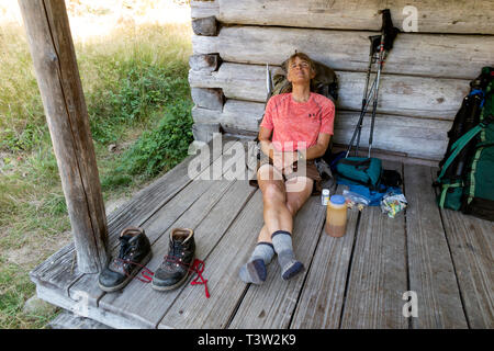 WA11057-00...WASHINGTON - Vicky Spring relaxing after a hike down Long Ridge in Olympic National Park. (MR# S1) - Stock Photo