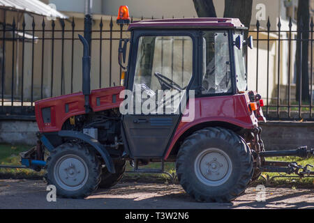 SAINT-PETERSBURG, RUSSIA - SEPTEMBER 24, 2017 Red tractor - Stock Photo