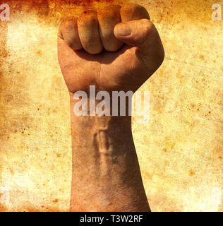 Raised clenched fist of adult male in the air as a threat of fighting. Retro grunge image. Socialism, communism, revolution - Stock Photo