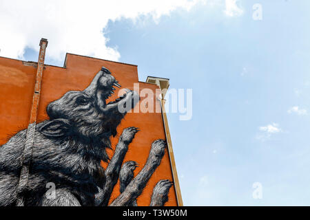 A 30 meters high mural depicting a jumping wolf, painted by the Belgian street-artis Roa, in Testaccio neighborhood in Rome, Italy. - Stock Photo