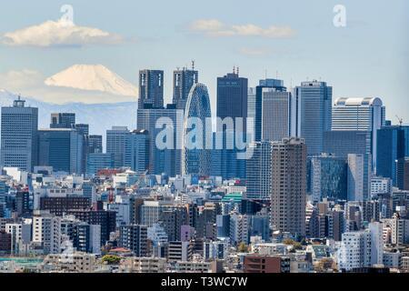 April 11, 2019, Tokyo, Japan - Skyscrapers of Shinjuku and Mt. Fuji view. - Stock Photo