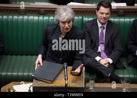 London, Britain. 11th Apr, 2019. British Prime Minister Theresa May (Front) speaks in the House of Commons in London, Britain, on April 11, 2019. Theresa May on Thursday faced tough questioning from lawmakers about the latest Brexit developments, including a call to resign, after she returned from Brussels with a new Brexit extension. Credit: UK Parliament/Jessica Taylor/Xinhua/Alamy Live News - Stock Photo