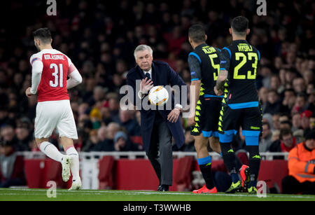 London, UK. 11th Apr, 2019. Napoli Manager Carlo Ancelotti throws the ball during the UEFA Europa League match between Arsenal and S.S.C Napoli at the Emirates Stadium, London, England on 11 April 2019. Photo by Andy Rowland. Credit: PRiME Media Images/Alamy Live News - Stock Photo