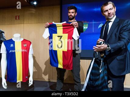 FC Barcelona's soccer player and founder and president of the Kosmos company Gerard Pique (C) poses with the Director-General of MoraBanc (C), Lluis Alsina, during a press conference held to present the sponsorship of MoraBanc for FC Andorra soccer club, in Andorra la Vella, 12 April 2019. EFE/ Fernando Galindo - Stock Photo
