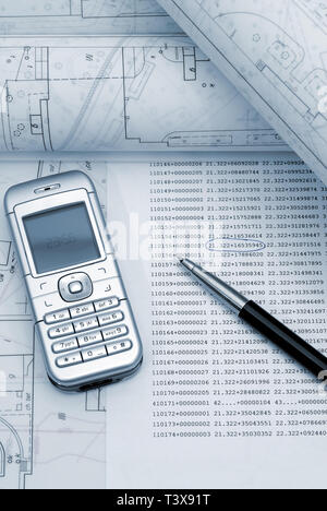Rolled architectural plans with phone and pen lying on drawing board. Picture in blue tone. - Stock Photo
