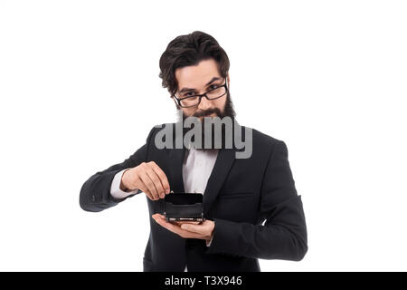 bearded businessman holding an open mini briefcase, isolated on white background, small business concept - Stock Photo