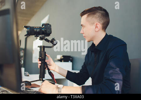Accessories included for youtuber or vlogger create content video. Camera setting on Gimbal stabilizer. - Stock Photo