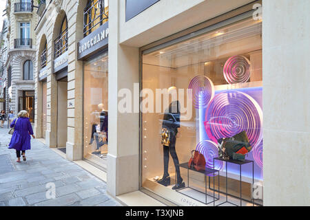 PARIS, FRANCE - JULY 22, 2017: Longchamp fashion luxury store in Paris, people passing, France. - Stock Photo