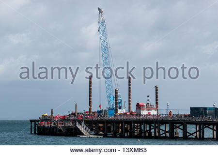 View across the bay to renovation work being carried out on the Victorian Pier at Swanage, Dorset, England, UK - Stock Photo