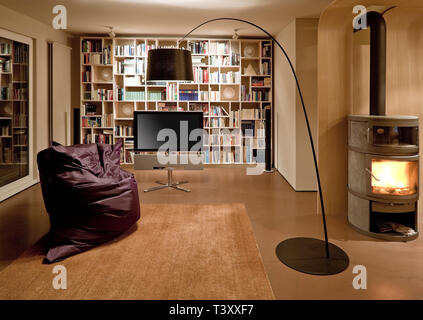 Bean bag chair and television in modern home - Stock Photo