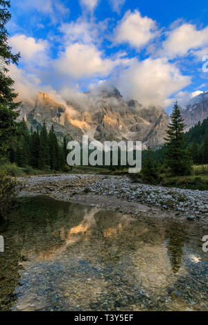 Val Vinegia, a small valley just below the high altitude pass of Passo Rolle in the Pale di San Martino group, Dolomites, Italy. The amazing peaks of  - Stock Photo
