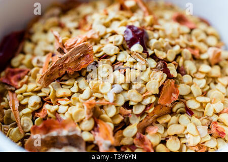Red Hot Dried Chili Pepper Flakes and Seeds. Organic Food. - Stock Photo