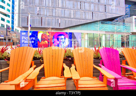 Toronto, Canada-12 October, 2018: Colorful chairs on King street in front if TIFF (Toronto International Film Festival) entrance - Stock Photo