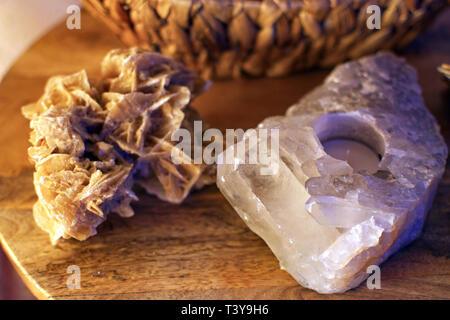 rock crystal tealightholder and desert rose on a table closeup macro - Stock Photo