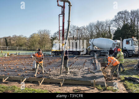 Presteigne, Powys, Wales, UK. Pumping ready mix concrete to form the floor of a new building - Stock Photo