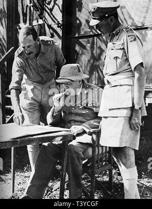Winston Churchill at the front of the Italian campaign discussing tactics with Generals Leese and Alexander. August 1944 - Stock Photo