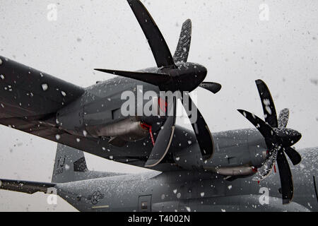 A 36th Airlift Squadron C-130J Super Hercules sits on the flightline during an unusually late season snow storm April 10, 2019, at Yokota Air Base, Japan. Through rain, sleet, hail, or snow, members of Team Yokota work to keep the mission going. (U.S. Air Force photo by Senior Airman Donald Hudson) - Stock Photo