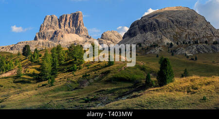 A view of Mount Averau (left) and Nuvolao (right), two peaks in the Dolomiti d'Ampezzo mountain range. Taken from the prairies of Falzarego Pass, a hi - Stock Photo