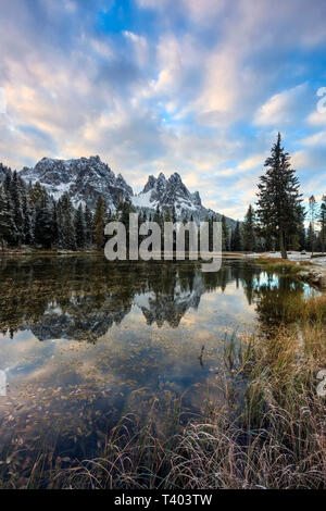 A view at sunrise of Lake Antorno, a small pond in the Dolomites of Ampezzo, surrounded by some of the best looking mountains of the world, such as Tr - Stock Photo