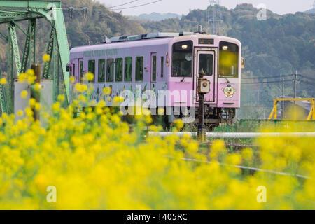 Local purple train of Nogata Heisei Chikuho Railway in Fukuoka, Japan. Taken in Nogata City, Fukuoka, Japan on  April 7, 2019 in s - Stock Photo