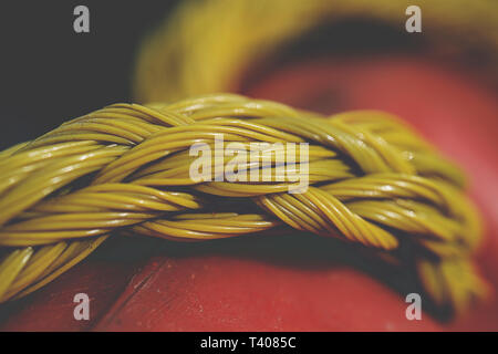 Yellow plastic rope on blur background