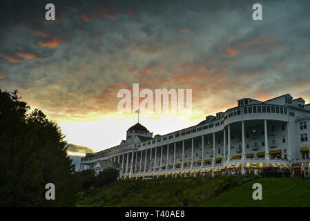 The historic Grand Hotel, built in 1887 and featuring the world's longest porch, captured at sunset, on Mackinac Island, Michigan, USA. - Stock Photo