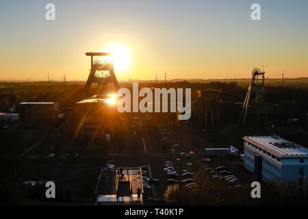 Herten, Ruhr area, North Rhine-Westphalia, Germany - Ewald colliery, Doppelbock-Foerdergeruest above shaft 7 at sunset, the coal mine was closed down  - Stock Photo