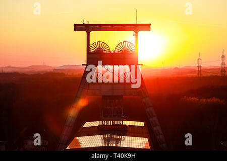 Herten, Ruhr area, North Rhine-Westphalia, Germany - Ewald colliery, Doppelbock-Foerdergeruest above shaft 7 at sunset, the coal mine was closed down  - Stock Photo