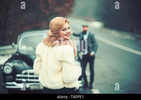 Photo girl, a man and a retro car. - Stock Photo