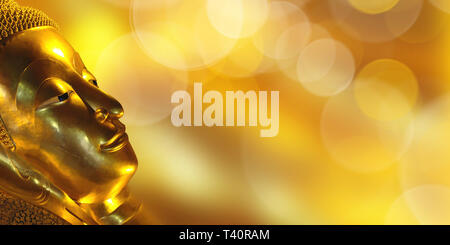 Golden Buddha head, panoramic background with copy space - Stock Photo